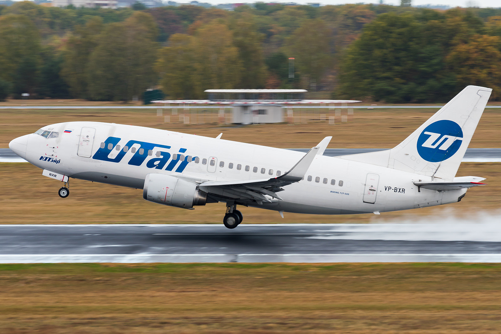Utair - B737 with a nice water spray on the runway.